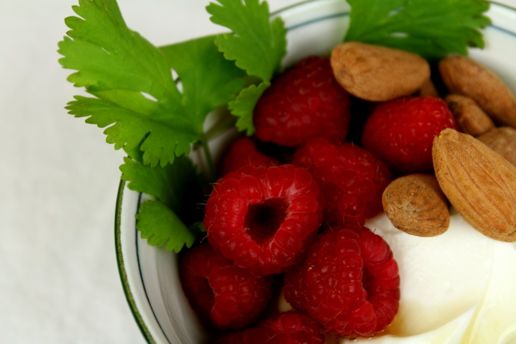 fresh raspberries w/ honey and roasted almonds over Greek yoghurt