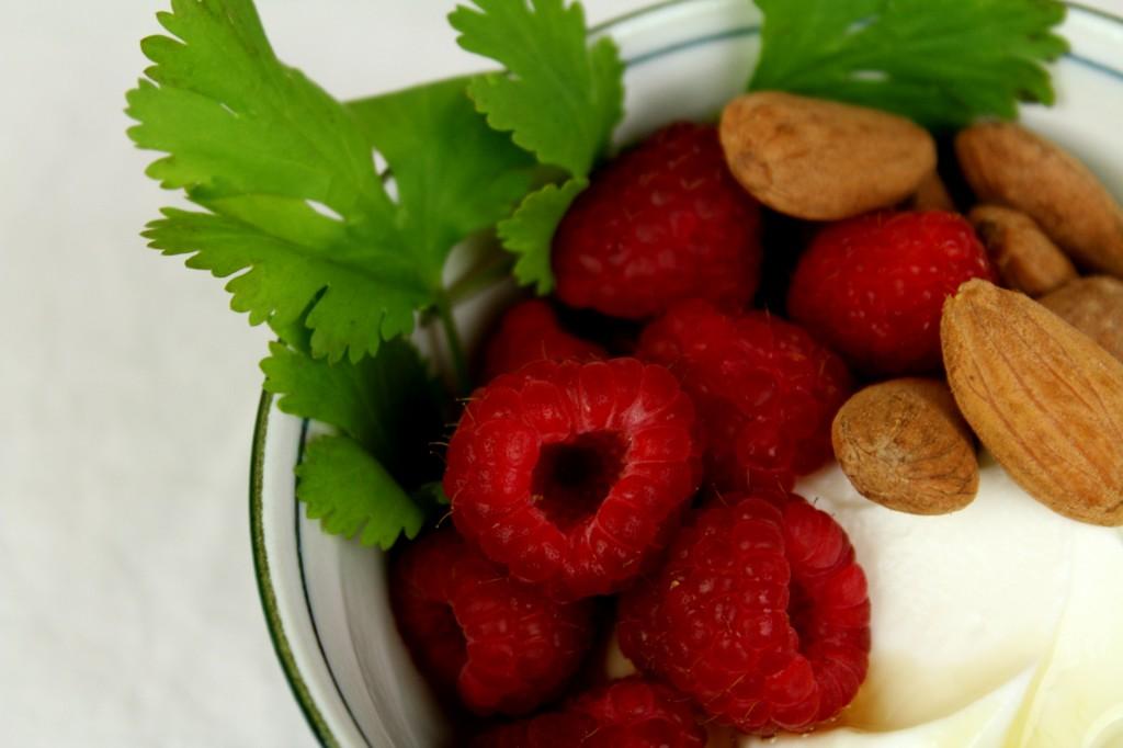 fresh raspberries w/ honey and roasted almonds over Greek yoghurt